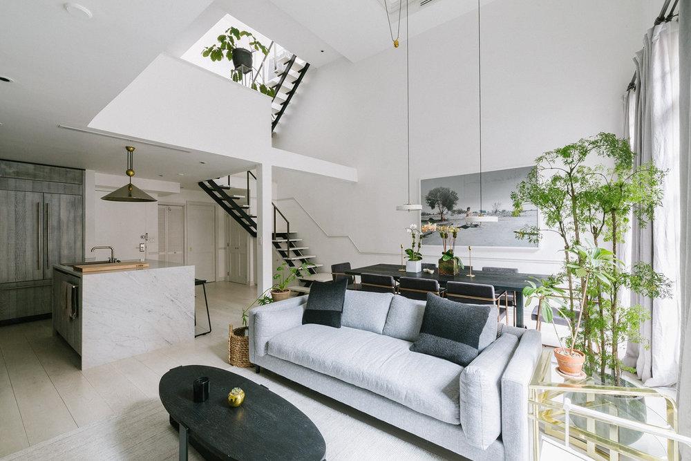 eastvillagetriplex-eau-livingroom-staircase.jpg