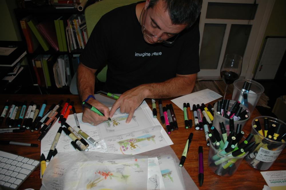 Juan Carlos coloring away. Notice his shirt... Imagine Peace