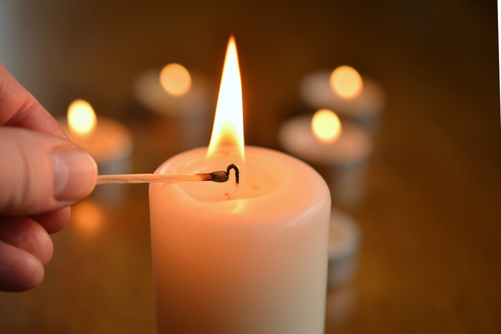 candle lighting with hand.jpg