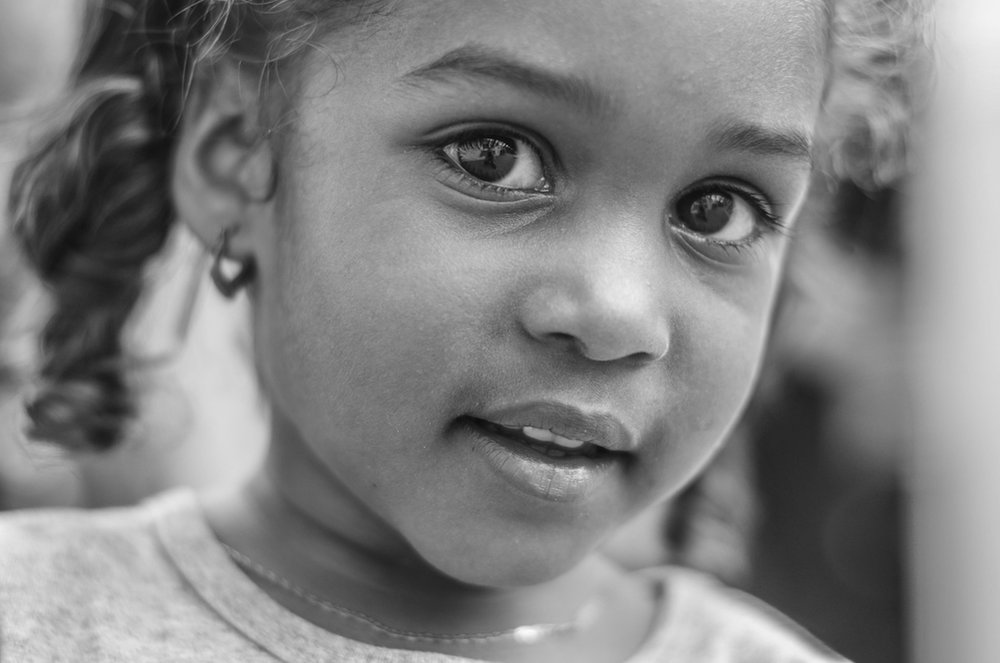 Picture of a present young girl looking at the camera
