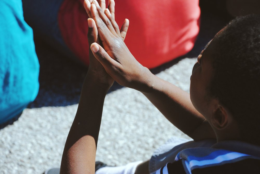 child mindfully looking at their hands