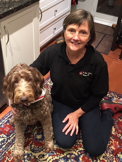 Mercedes the Labradoodle and her owner, Bev