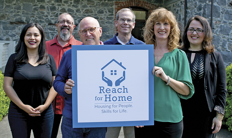 The Reach for Home team with the new logo.