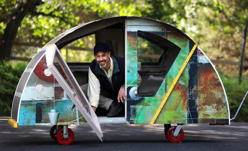 "Sebastopol architect Ken Berman designed a mobile shelter he calls ""The Turtle"" that can be towed by a bike. The shelter includes LED lighting, storage and an iPad mounting system. (John Burgess/The Press Democrat)"