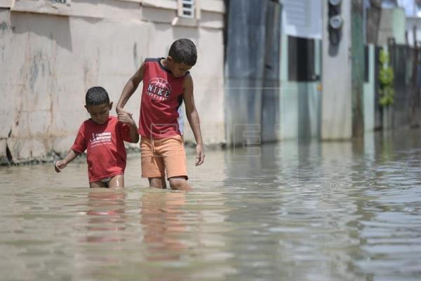 This in Dominican Republic, kids walking in knee deep water. We need your help with Anything you can give.