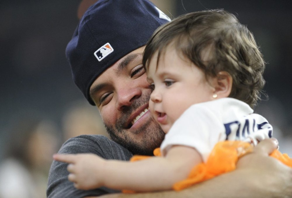 Jose Altuve and his daughter Melanie, celebrating her dad's world series win.