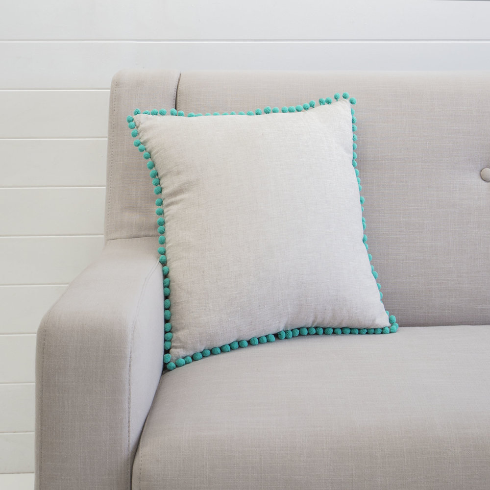 TEAL POM POM CUSHION