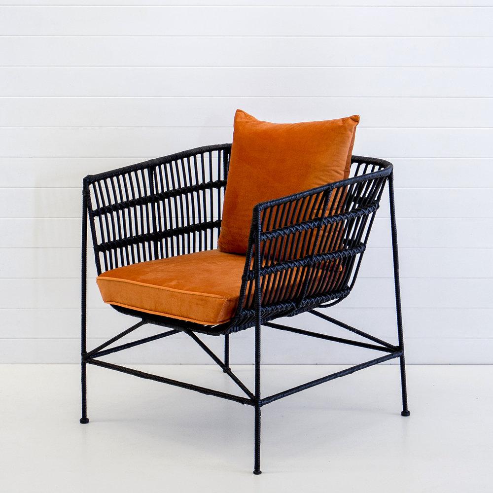 Indie black armchair with rust velvet cushions