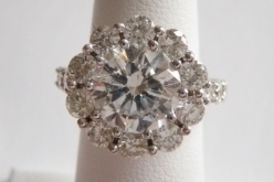 Diamond Halo Mounting - Custom designed diamond halo mounting to surround the 3 ct. brilliant cut diamond set in platinum with diamonds on the shoulders of mounting creating a beautiful ring.
