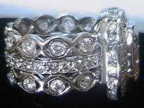Opulent Elegance - The elegance of an eternity band is classic and the prominence of large diamond makes a statement. This Morgan Jewelers' customer did not want to choose between the two, so instead she opted for a custom creation that blended the styles.The result was a unique piece that showed her personal style in opulent elegance. It showcases a 4 ct cushion diamond mounted on bands with over 70 smaller stones totaling 3 ct wt.