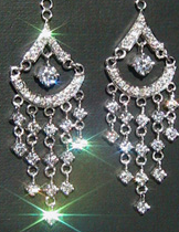 Personal Statement Piece - After searching high and low for the perfect pair of earrings, a Morgan Jewelers' customer concluded that only a custom piece would do. She owned a beautiful pair of diamond studs that she loved, but were not formal enough for evening wear. Finding an elegant pair of high fashion costume earrings, she brought these in to replicate in platinum and diamonds. The final piece was an outstanding statement of her personality with a contemporary flair.