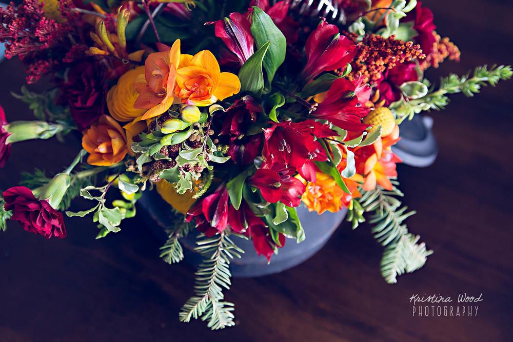 flower arrangement in teapot