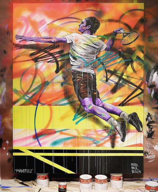 "Mark Paul Deren  Canvas of Roger Federer for the launch of the NikeCourt Vapor RF x Air Max 95 ""Greedy"" at Nike Miami.    V  iew article"