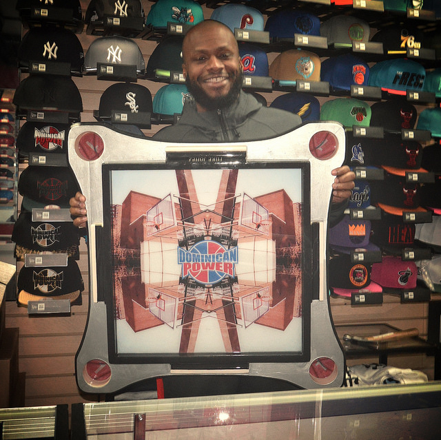 Dyckman's own Mike Jonez with his one of one custom Dominican Power domino table
