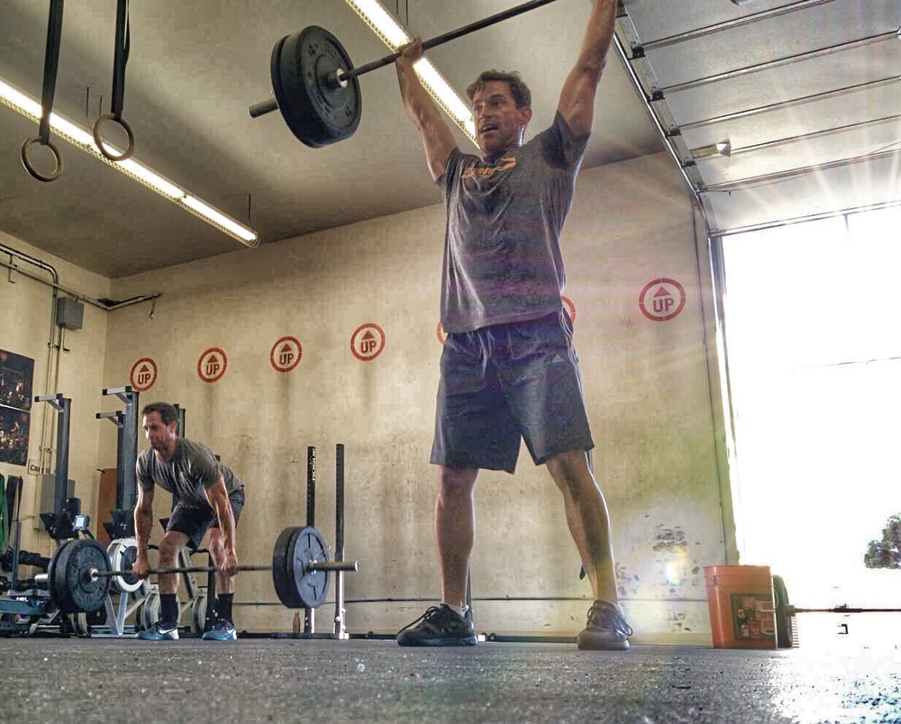 The Ellison Brothers getting after Monday's WOD during open gym. Nothing like the support, and push, from a sibling.