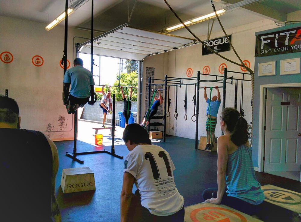 Everyone UP! L-sits or pull ups, working on that body weight mastery.  Gymnastics before weights.