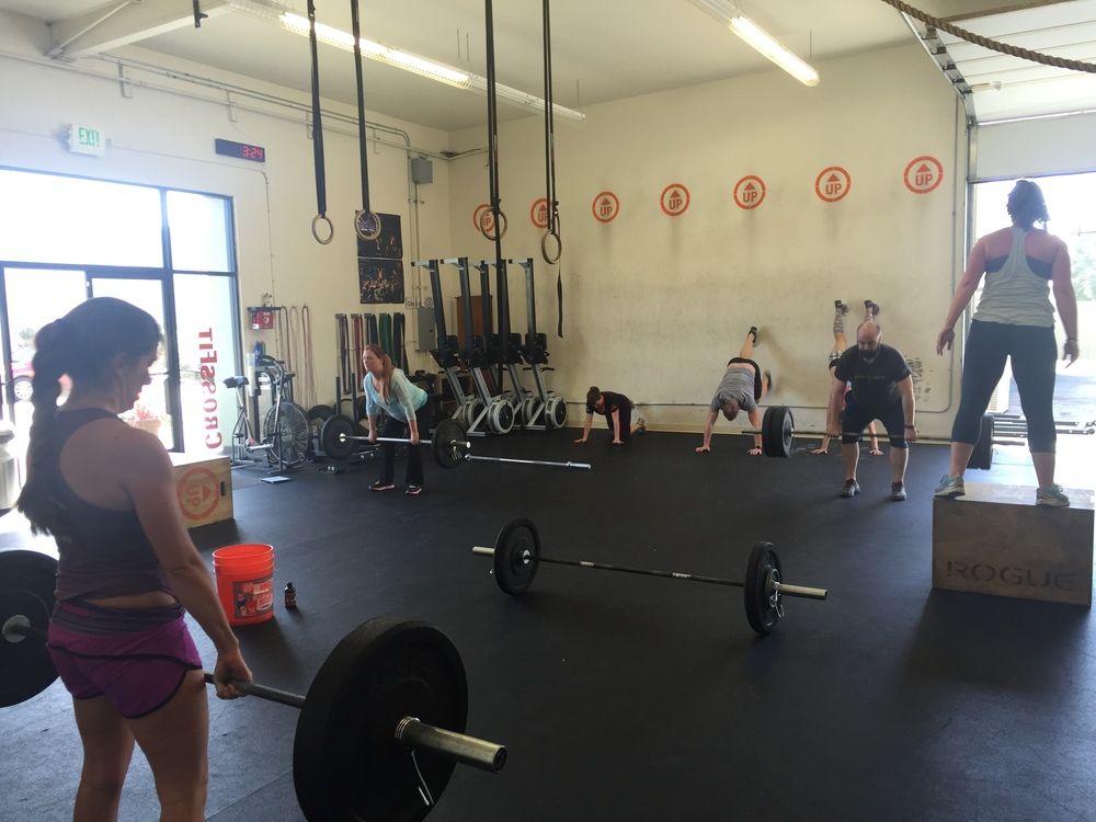 Barbells and bodies in motion.  Just another day at UP!