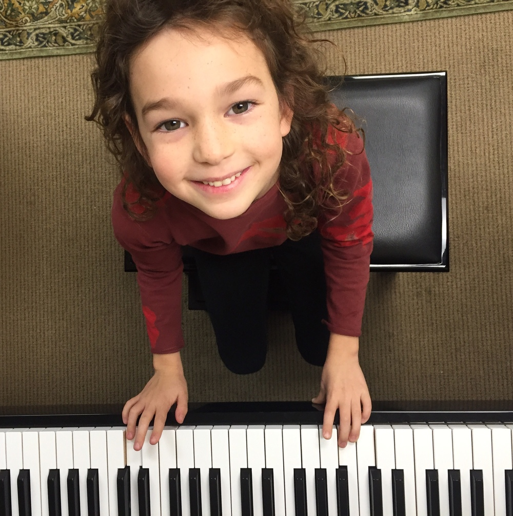 Bridget learns piano with a smile!