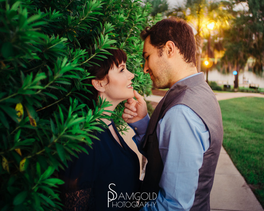 Image of an engaged couple being photographed at Rollins College in Orlando FL taken by Samgold Photography