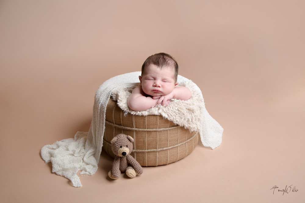 Photograph of newborn baby in tub - Photographer in Bournemouth, Dorset