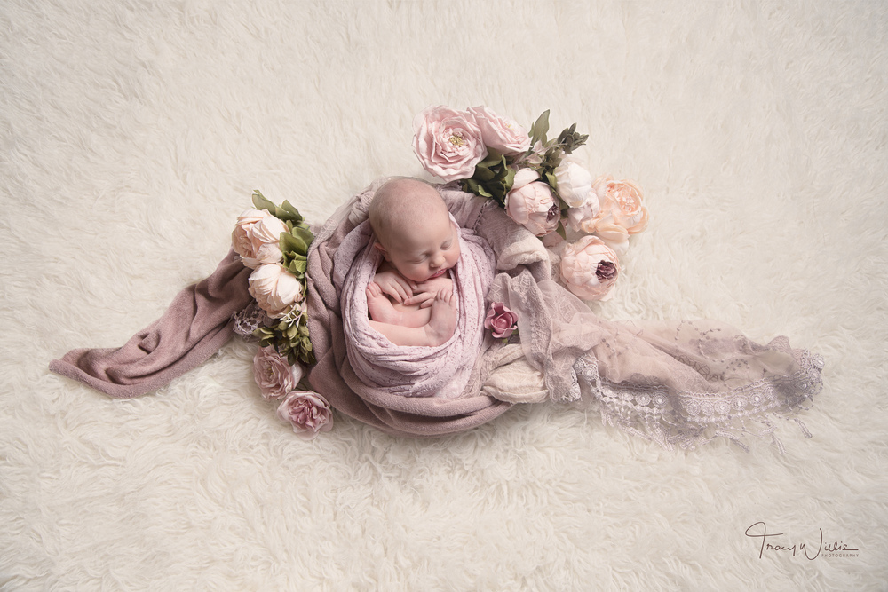 Baby in pink wrap by photographer covering Bournemouth and Poole, Dorset