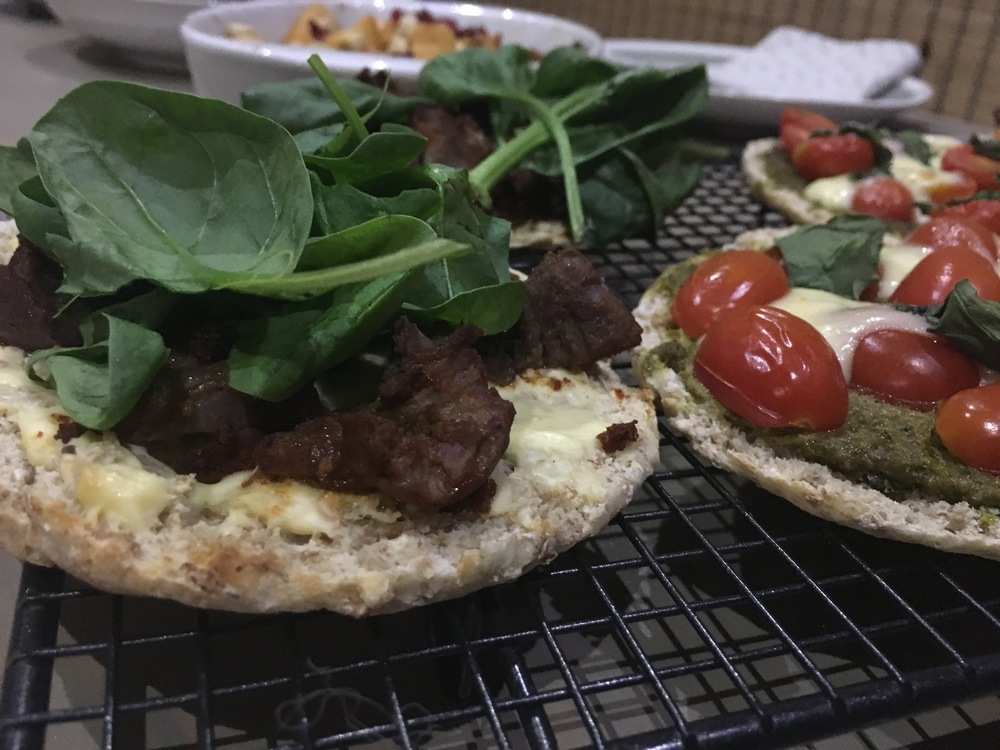 Lamb kebab pita pizza with cream cheese and rocket