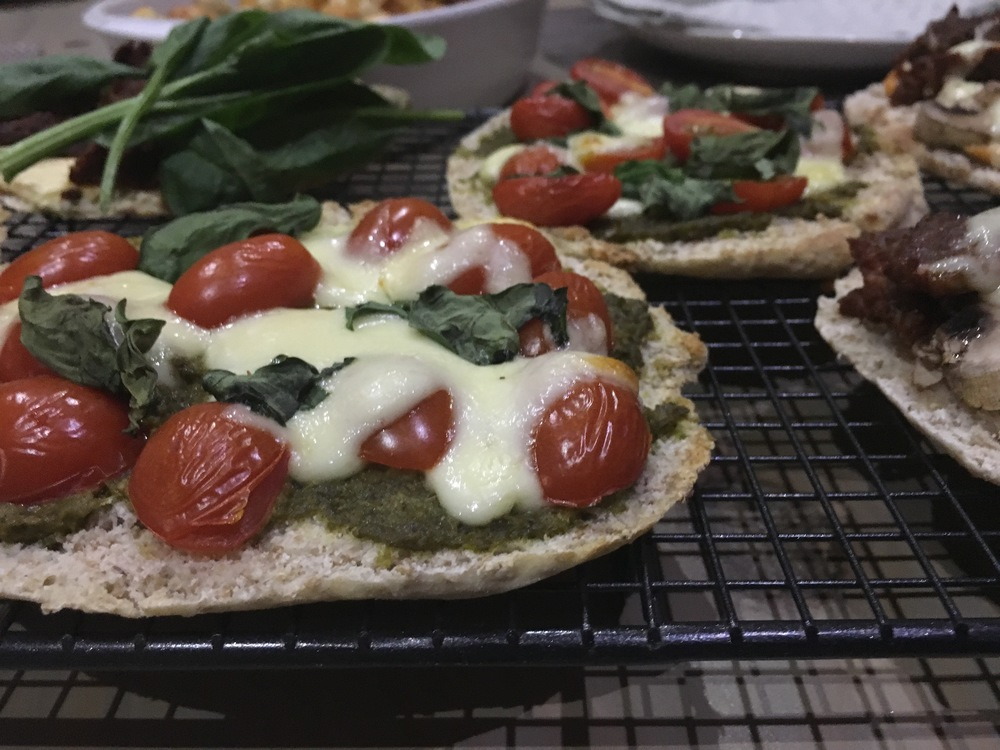 Caprese pita pizza with mozzarella, basil pesto and rosa tomatoes