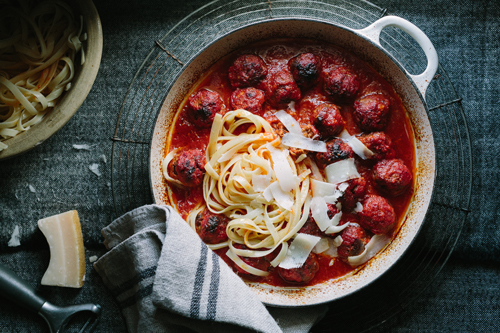 Baked lamb meatballs in a smoky tomato sauce with parmesan shavings and freshly cooked tagliatelle. Photography & co-styling by Tasha Seccombe.
