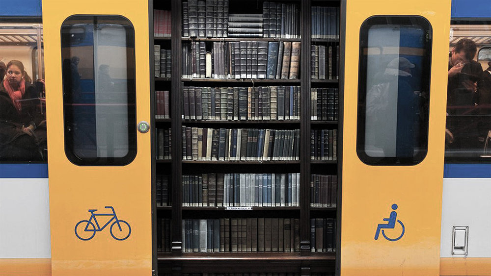 Thanks to a simple joint venture, all NS trains transform in a kick-ass riding news library.