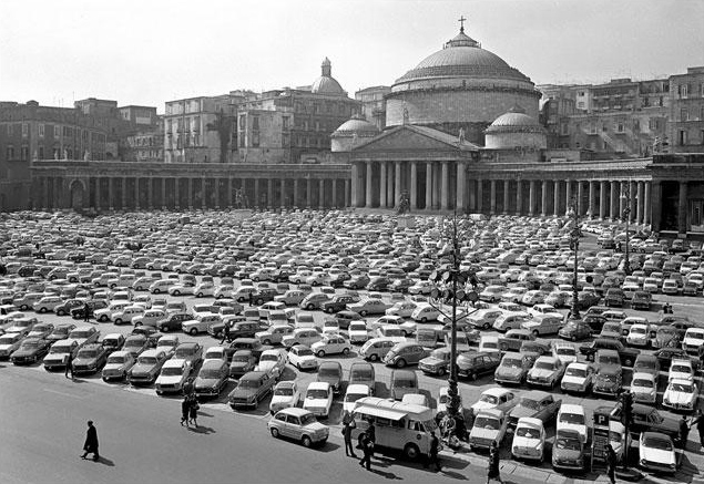 The sixties at Piazza del Plebiscito, Naples, Italy. The collective spirit of community gives a new expression to public space. It would take until 1994 for the square to become car-free again.