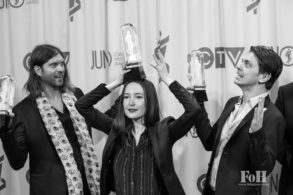 July Talk posing with their Juno Awards