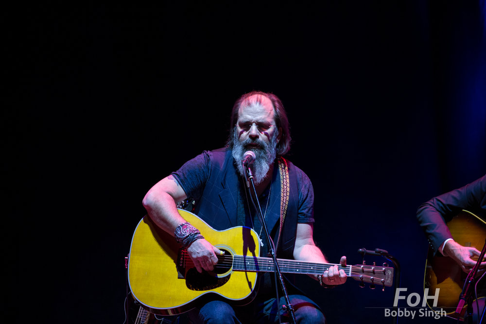 Steve Earle performing at the Lampedusa Concert for Refugees fundraiser at Massey Hall in Toronto