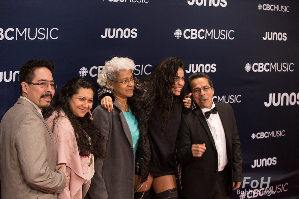 Jessie Reyez with her family on the 2019 JUNO Awards red carpet at Budweiser Gardens, in London, Ontario, CANADA