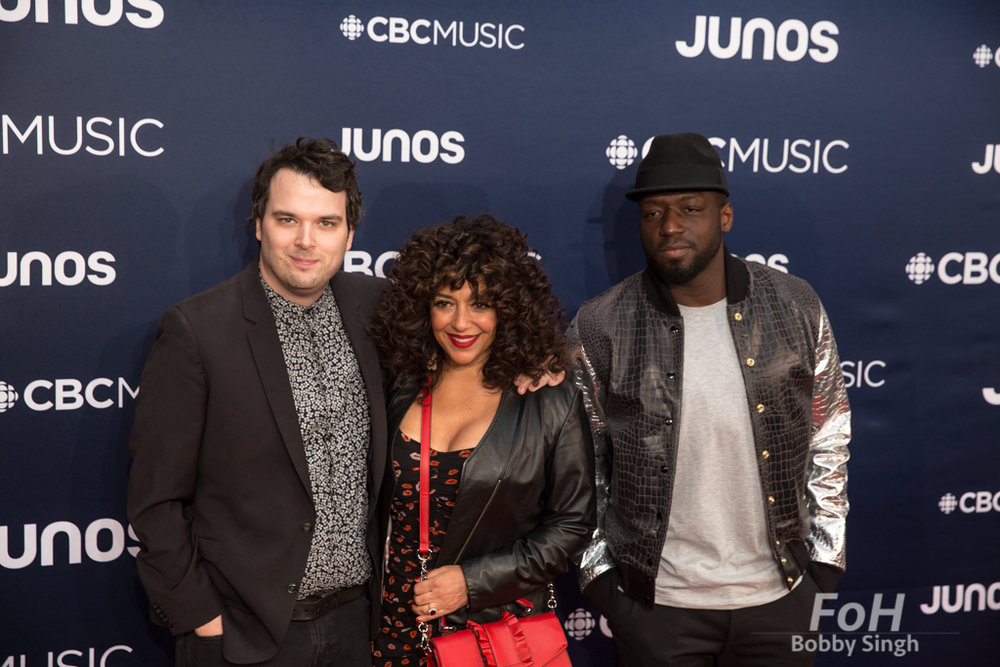 CBC Radio hosts Tom power, julie Nesrallah and Odario Williams on the 2019 JUNO Awards red carpet at Budweiser Gardens, in London, Ontario, CANADA
