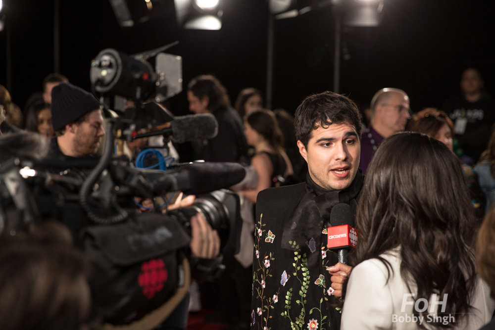 Jeremy Dutcher interviewed on the 2019 JUNO Awards red carpet at Budweiser Gardens, in London, Ontario, CANADA