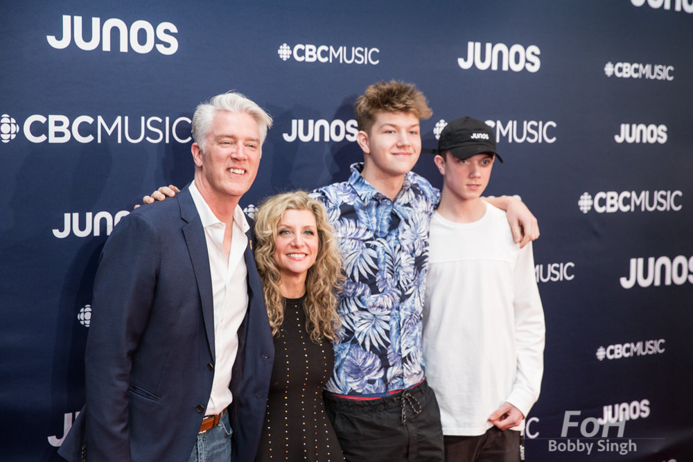 CARAS CEO Allan Reid, Kim Stockwood and family on the 2019 JUNO Awards red carpet at Budweiser Gardens, in London, Ontario, CANADA