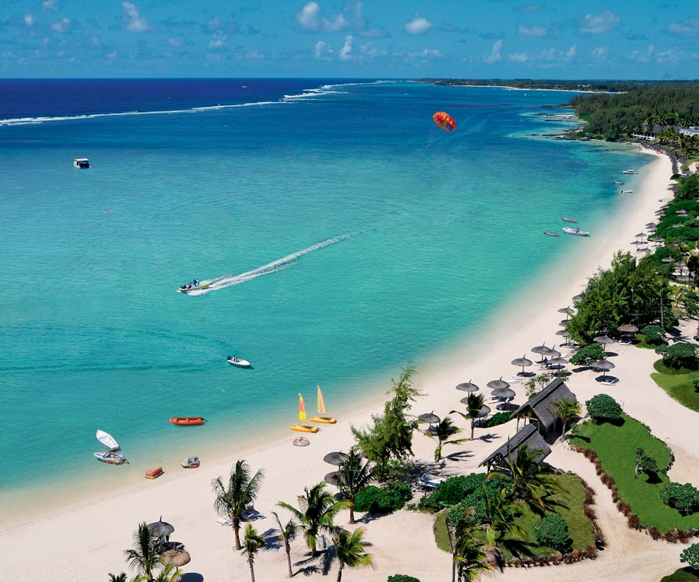 Long Beach, Mauritius - Mauritius' famed Belle Mare Beach is fringed with coral, dusted with white sands and bejewelled with crystalline waters. Long Beach is the perfect setting from which to take full advantage of this spellbinding location. Slip into a beach cabana and snooze the day away as butlers deliver refreshments right over to your spot on the sand. Or wade into the crystal-clear lagoon and enjoy complimentary snorkelling, have a go at windsurfing or join the crew on a glass-bottom boat ride to discover the marine life swirling below.Then, replenish yourself with lunch at the beachside Tides Restaurant, which serves up delicious fresh fish, crisp salads and dreamy deserts. We're sure you'll be spending a lot of your time on the beach here, but to get even closer, we recommend upgrading to a Junior Suite Ocean Front for exceptional ocean views, or an exclusive Long Beach Executive Suite with a prime location right on the sand.7 nights from £1,459 per person sharing a Junior Suite on Half Board.OFFER: Save up to 40% plus complimentary golf green fees.STAY: 16 Apr 2018 - 06 Jan 2019.