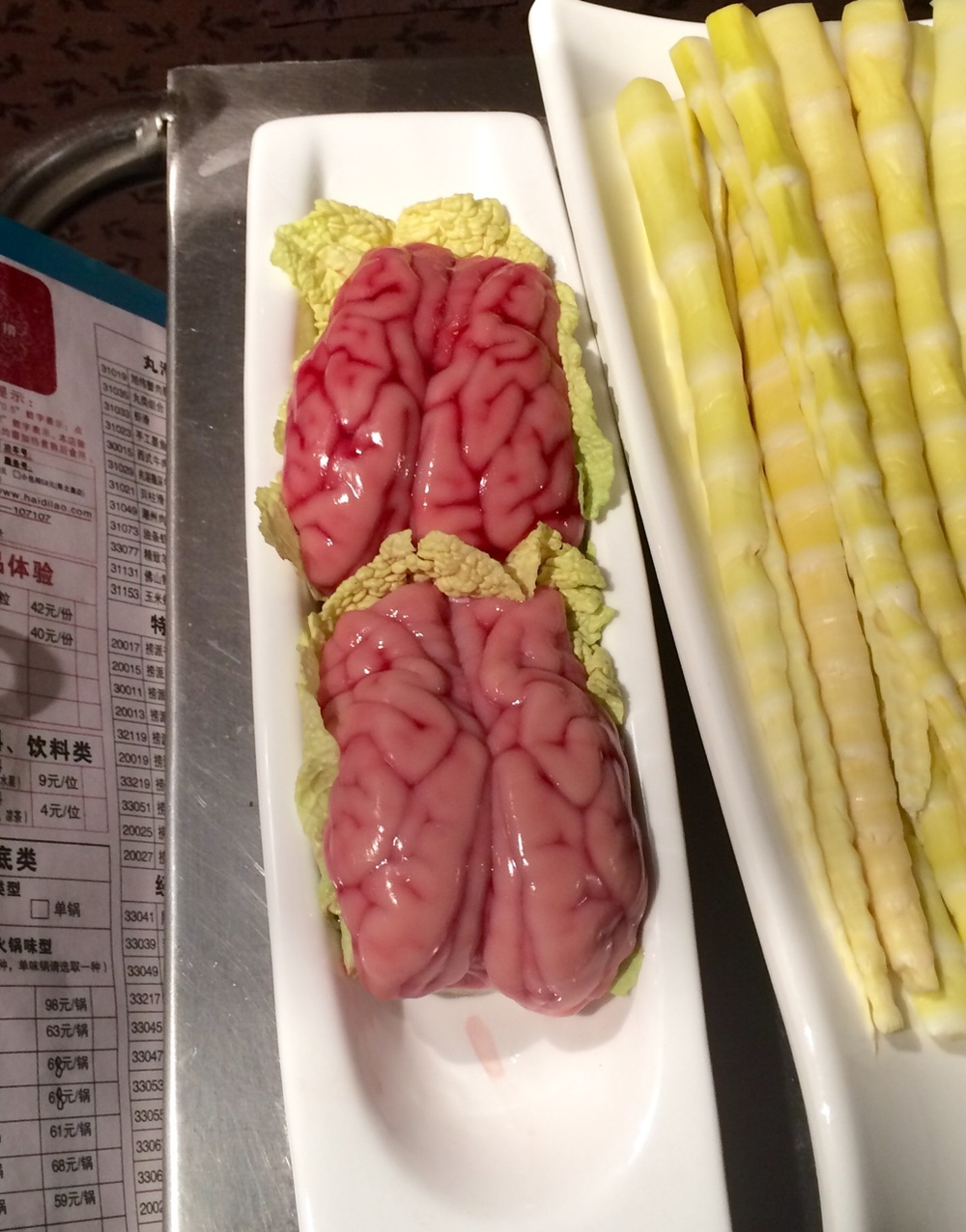 Pig brain at a hot pot place. It was… Not tasty