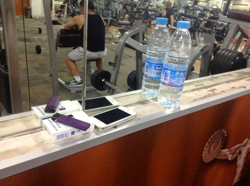 The essentials for Chinese dudes at the gym. These guys will sit on the bench press for an hour, and have a smoke break after each set in the hallway. This probably explains why they are so skinny. I'm pretty sure that grits aren't going to help them really pump out that last set of 20 kilos. GO HOME CLOWN.