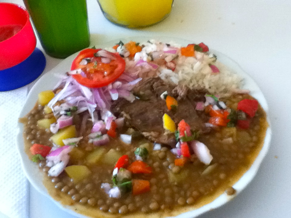Yum yum yum, 'Lentejitas con Bistek', another delicious option at the Menu down the street. (Lentils w/ potatoes, rice, steak, and an onion/tomato salad covered with lime juice and ají)   Started classes today and to no surprise, I only had 1 student. So what better way to spend 2 hours than for her to describe, in detail, the last season of a Telenovela called 'Rubi'. After listening to an intense combo of English and Spanish plot twists and character definitions, I was hooked.