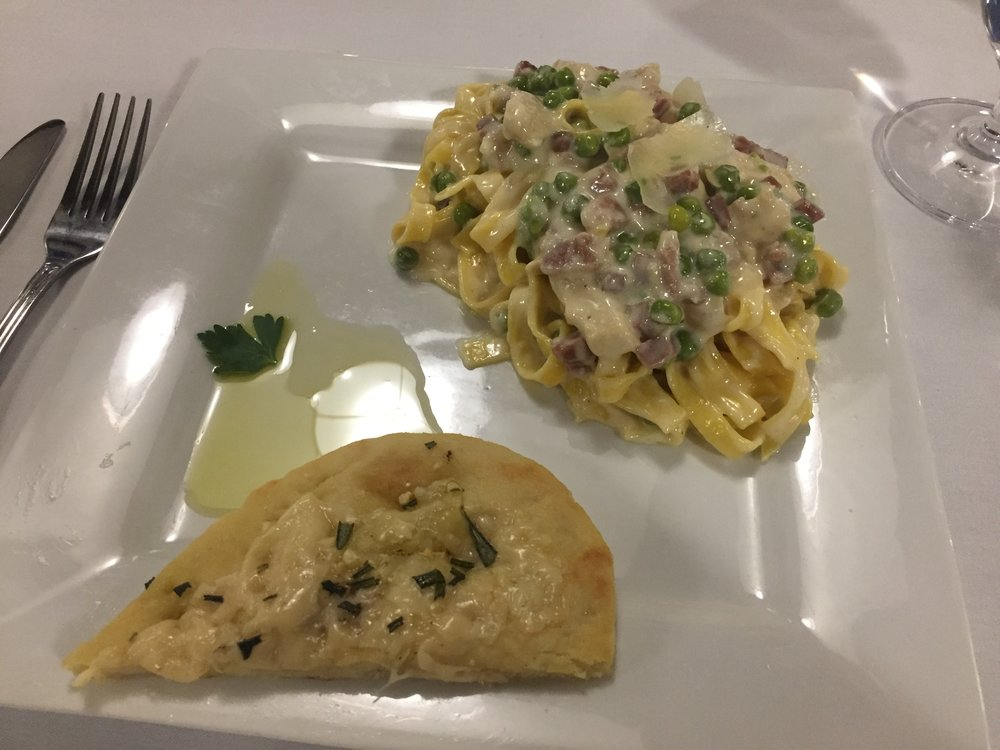 Fettuccine Pasta with Prosciutto, Chicken, Peas, and a Cream Sauce with Baked Rosemary Flatbread