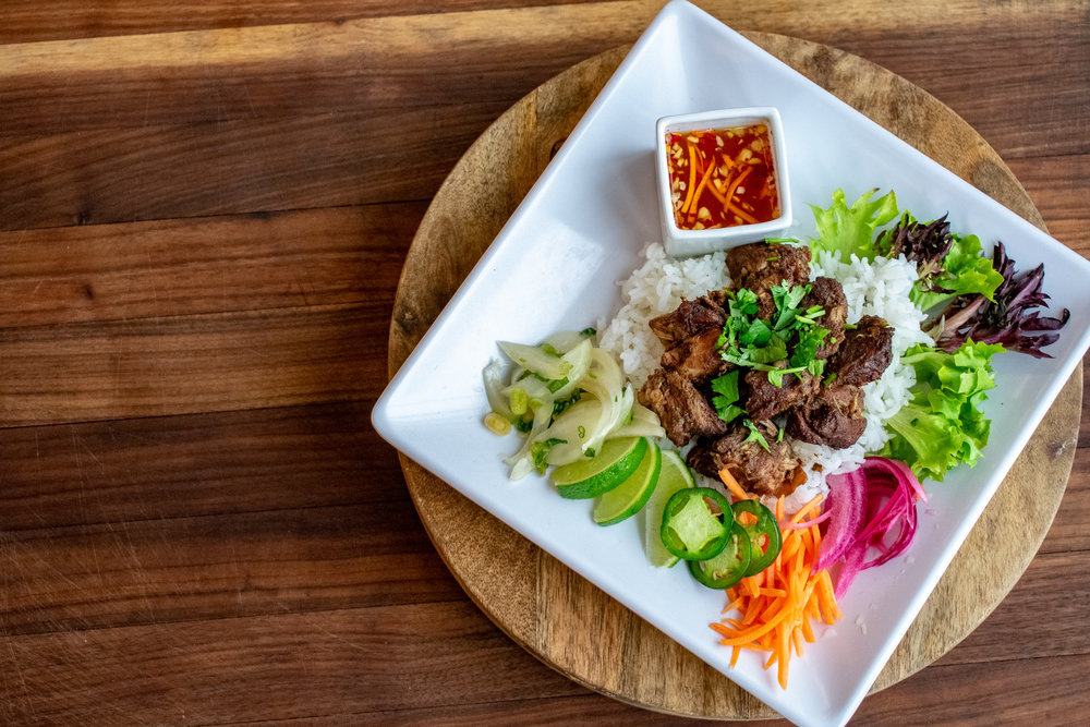 Five-Spiced Braised Pork rice bowl with fresh vegetables & lime