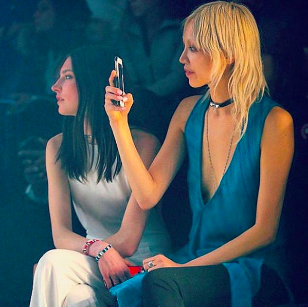 Soo Joo in Pre-Fall '16 teal flutter top & Jacquelyn in Resort '16 pearl halter-back jumpsuit sit front row at the Fall '16 Show.