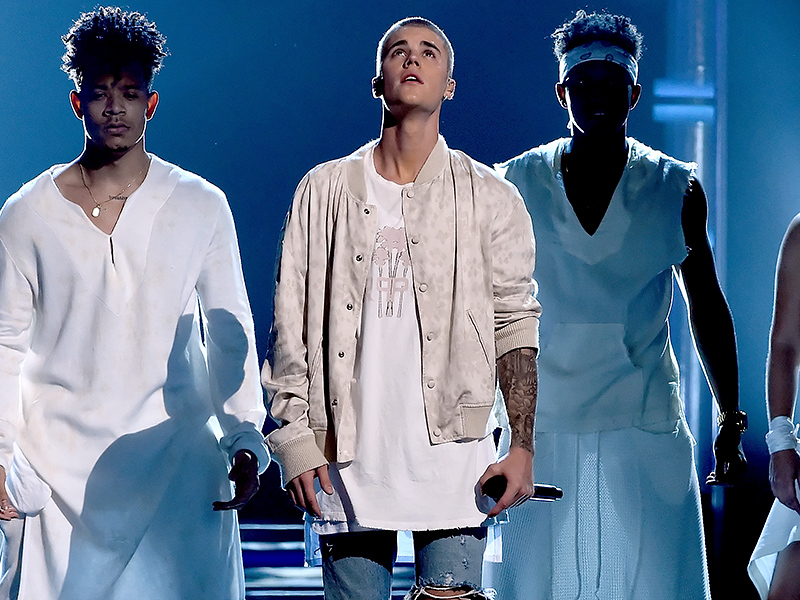 Justin in custom purpose palm tee & tribal bomber with his Baja Baes -all drenched Baja East at Billboard Music Awards 2016