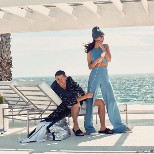 Emily baja babing with Nick Jonas in our cut-out jumpsuit for Glamour Magazine's June 2016 issue.