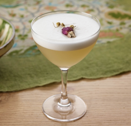 District Sour - 1oz Capitoline White.75oz Green Hat Navy Strength Gin.5oz chamomile syrup.5oz fresh lemon1 egg whiteDry shake egg, citrus, vermouth and ginAdd ice and re-shake vigorouslyDouble strain into coupeTop with dried rose petals and chamomile flowers