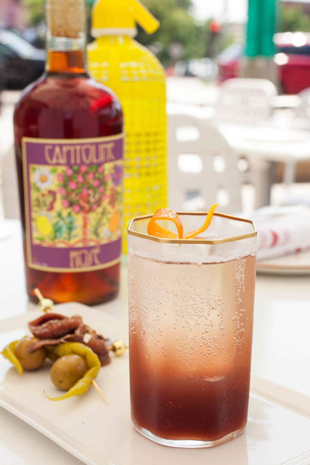 Rosé Vermouth and Soda - 2oz Capitoline Rosé over ice2oz seltzerGarnish with orange and green olive