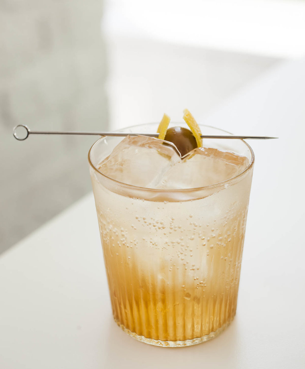 White Vermouth and Soda - 2oz Capitoline White Vermouth over ice2oz seltzerGarnish with lemon peel and green olive