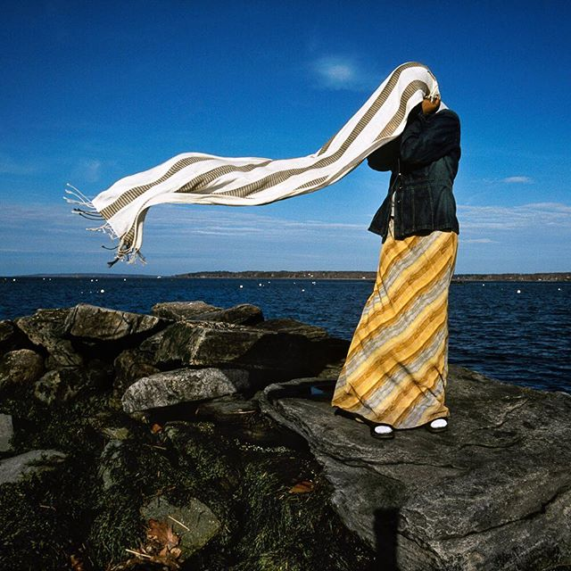 INTERNATIONAL WOMEN'S DAY :: Over a decade ago, when I was living in Portland, Maine, a large population of Somali refugees settled in the area and the cultural landscape was changing fast. Parts of the community embraced the newcomers and other parts struggled with the change. I wanted to know more about my new neighbors and as a woman, I was most interested in the teenage girls. I knew from experience female adolescence is a challenging and exciting time (to put it mildly) - but I couldn't imagine navigating those years as a muslim girl coming of age in a western world.  I ended up spending a lot of time with Naima (pictured here) who had fled Somalia with her family, lived for years in a refugee camp in Africa and was eventually resettled in the United States in 2001. When I met her she was 17 years old, juggling school and friends while also taking care of her parents who struggled more than she did with the language and new surroundings. They relied on her for many adult tasks and expected her to uphold and represent their culture.  I learned a lot from Naima - she was brave and funny and had a giant heart. In this picture we were hanging out by the harbor when the wind grabbed her head scarf - she held tight and struggled to gather it back together to reshape it into something that would hold. #internationalwomensday #girlpower #maine #refugeeswelcome