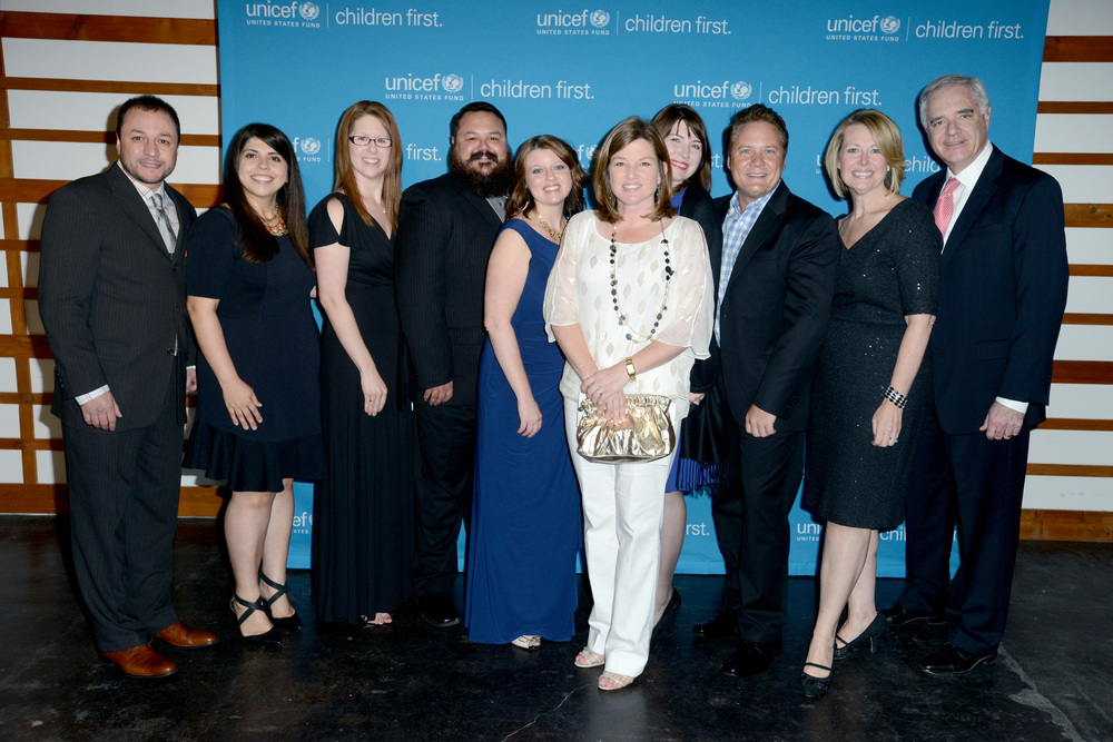 (L-R) Michael Mantilk, Maria Canada, Adrienne Long, Brian Price, Kim Pierson, Rachel Harris, Elizabeth Teer, Dwayne Prirott, Sharon Leite, and Greg Humenesky, of Pier 1 Imports,  Photo by Cooper Neill/Getty Images for US Fund for UNICEF